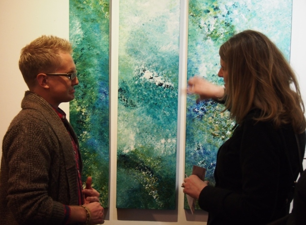 Carlene Egan chatting with Jonathan McBride about Erratic Shore Triptych by Rachel McBride