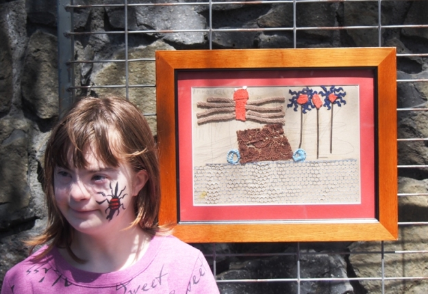 Emma Matthews was the face of optimism on October 9 with her face-painted spider and her well-received work Spider Goes on Holiday