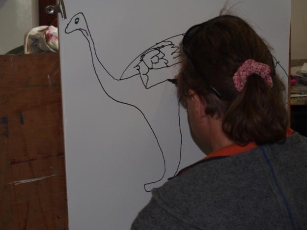 Dan at the easel working on his emu-like bird in Marina Troitsky's studio