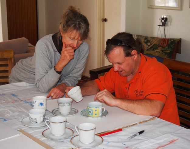 Dan getting the feel for cups and saucers with artist Judi McGuigan