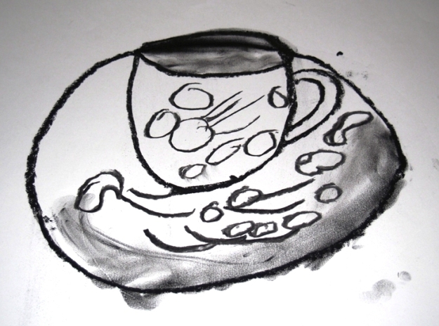 Cup and saucer by Dan with support from artist Judi McGuigan
