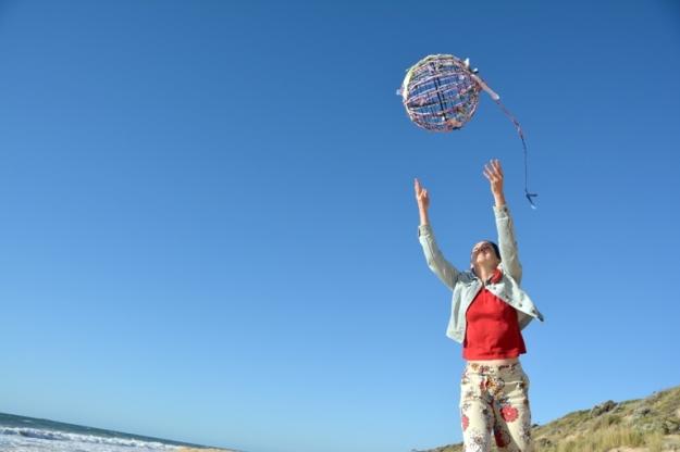 Celebrating the One World Globe on a Bunbury Beach.  Photo: Carensa Werder
