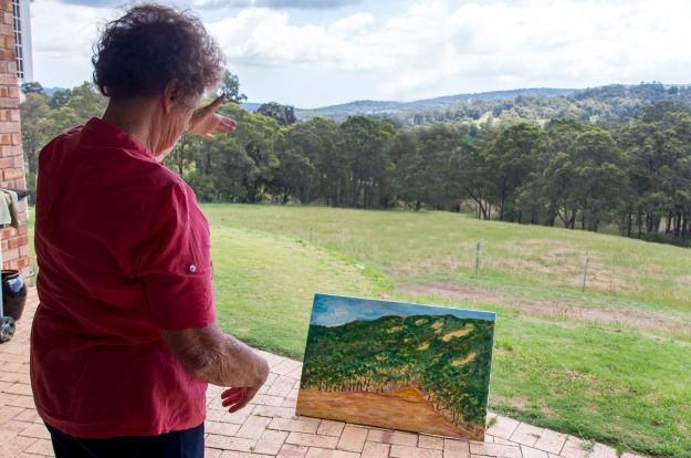 Pat juxtaposing her vista with a painting in progress. Image by Rob Cox