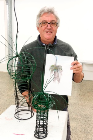 Ric Stacey with grass trees and drawing. Photo by Rob Cox