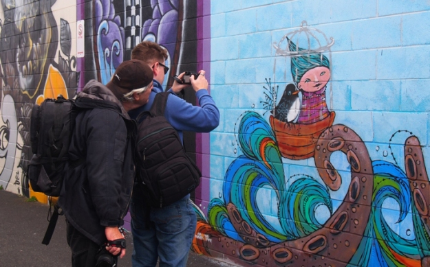 Rob Cox and Sam Everitt with Sharon Hinchliffe mural